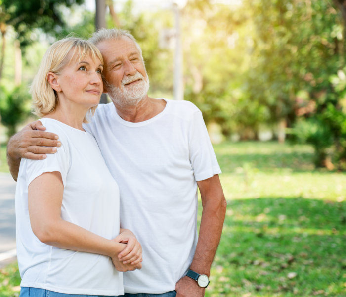 Senior Caucasian Women and men Standing in garden during summer Which is lover who has been caring for long time Take care of health And travel together in retirement Concepcion insured the elderly